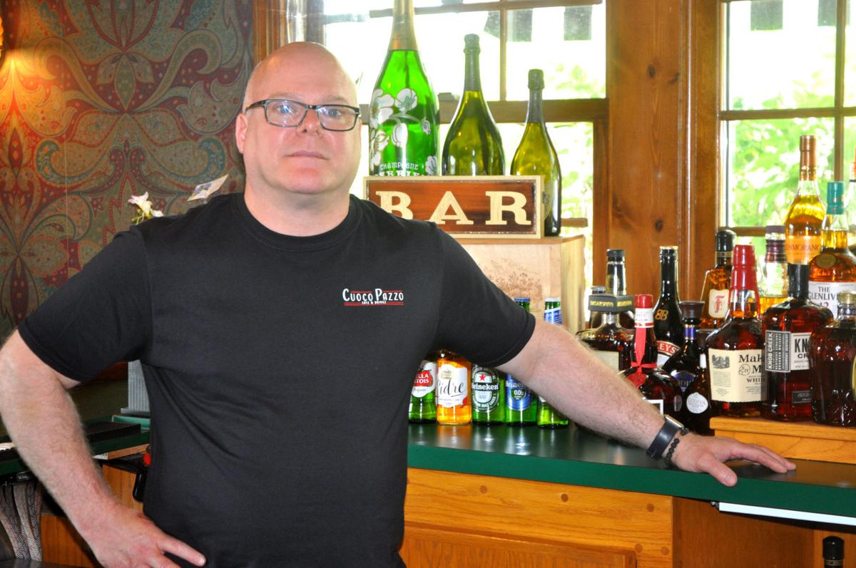 Eric Webber, owner of Cuoco Pazzo Eatz & Drinkz, 393 N. Edwards Blvd. stands in the bar area