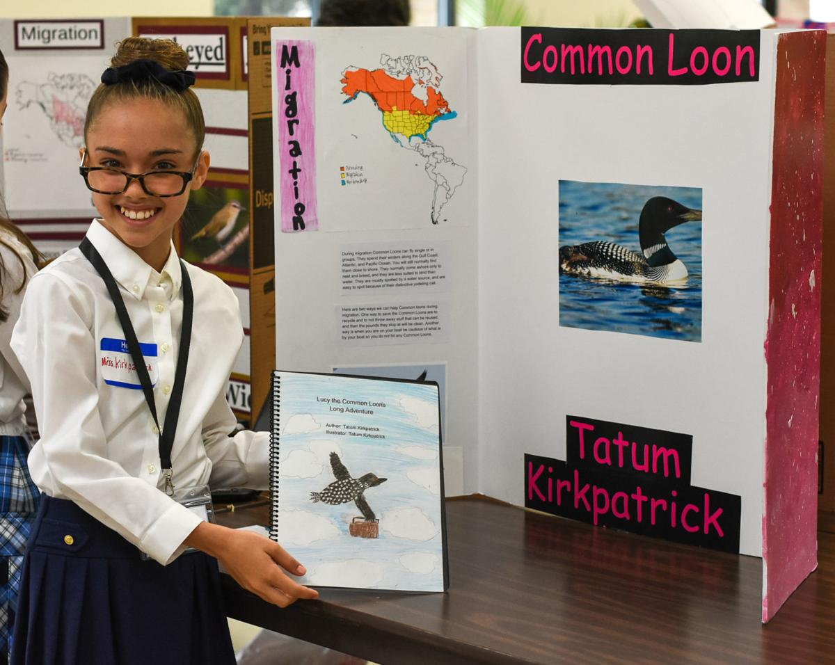 Tatum Kirkpatrick, fifth-grade student at St. Francis de Sales School, was honored of her bird story book