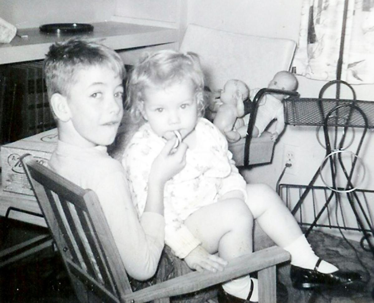 Michelle Bie Love as a child with her brother
