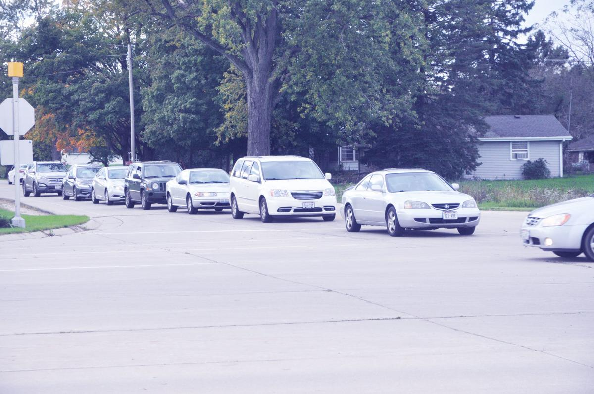 Vehicles on Bloomfield Road wait to make a turn onto Highway 120 as traffic travels along the highway