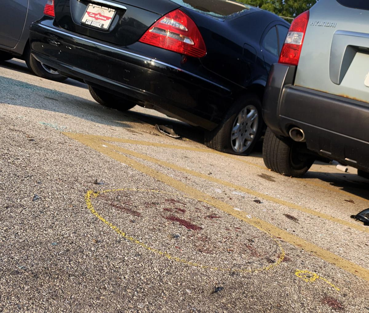 Blood marks and police investigator's marking on the parking lot of Car Source, 6226 Sheridan Road, are shown here, near where Joseph Rosenbaum was shot and killed Aug. 25.