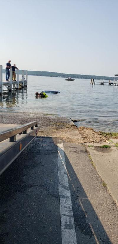 Car rolls into the lake