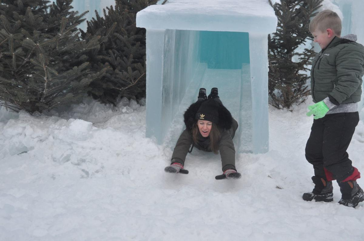 Maggie Finley of Beloit has fun on one of the slides that are featured in the ice castle structure