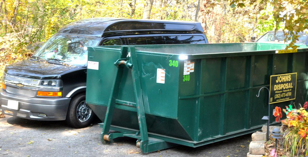 Wayne M. Rogers, 58, has installed a dumpster on his property to remove debris