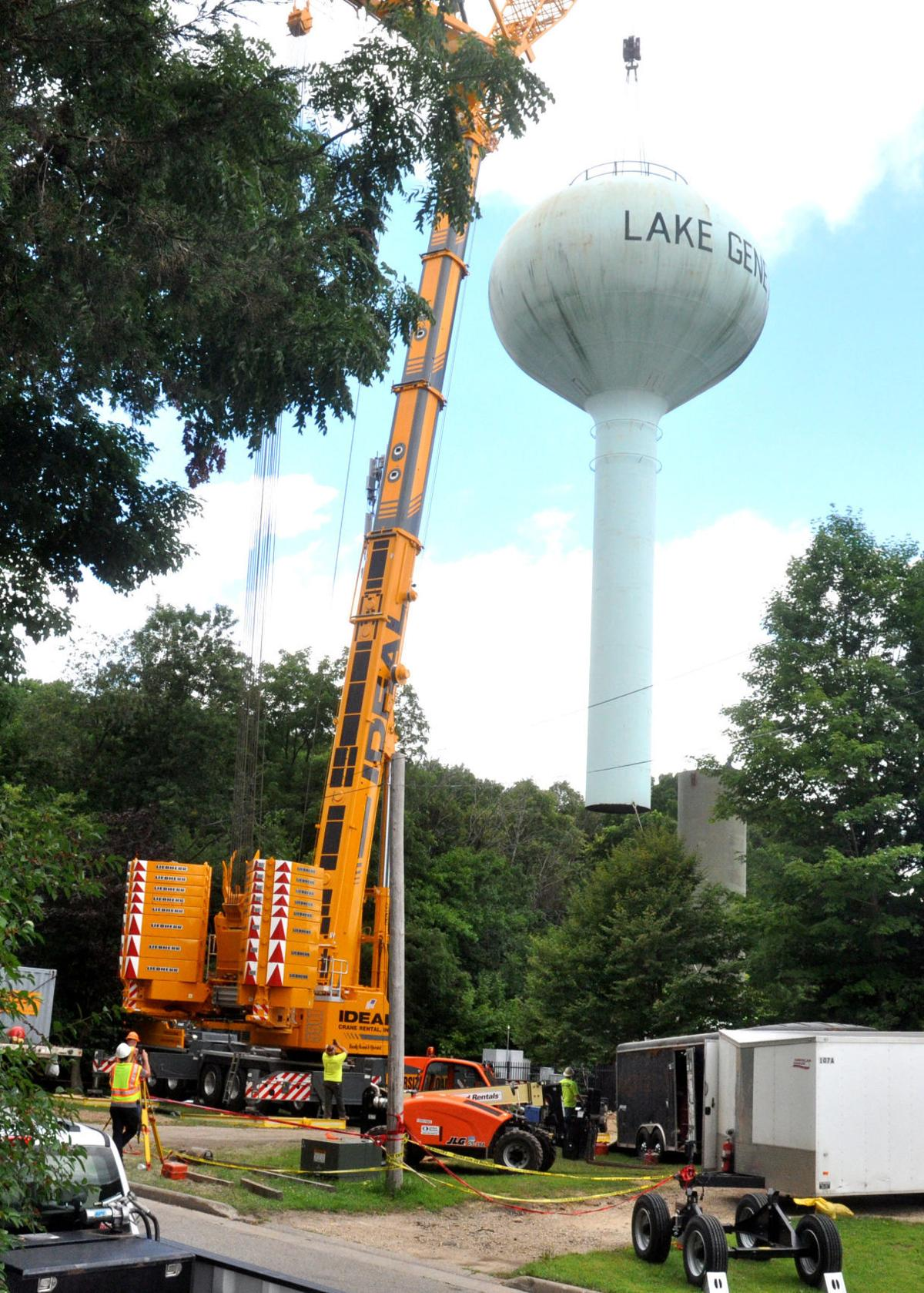 City crews hoist the Dodge Street water tower on top of its new 30-foot addtion