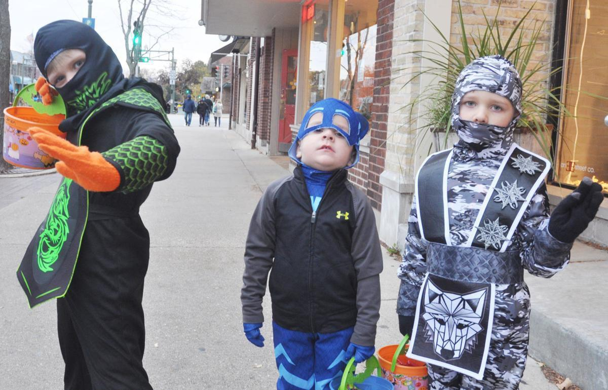 Kids trick or treating Halloween downtown