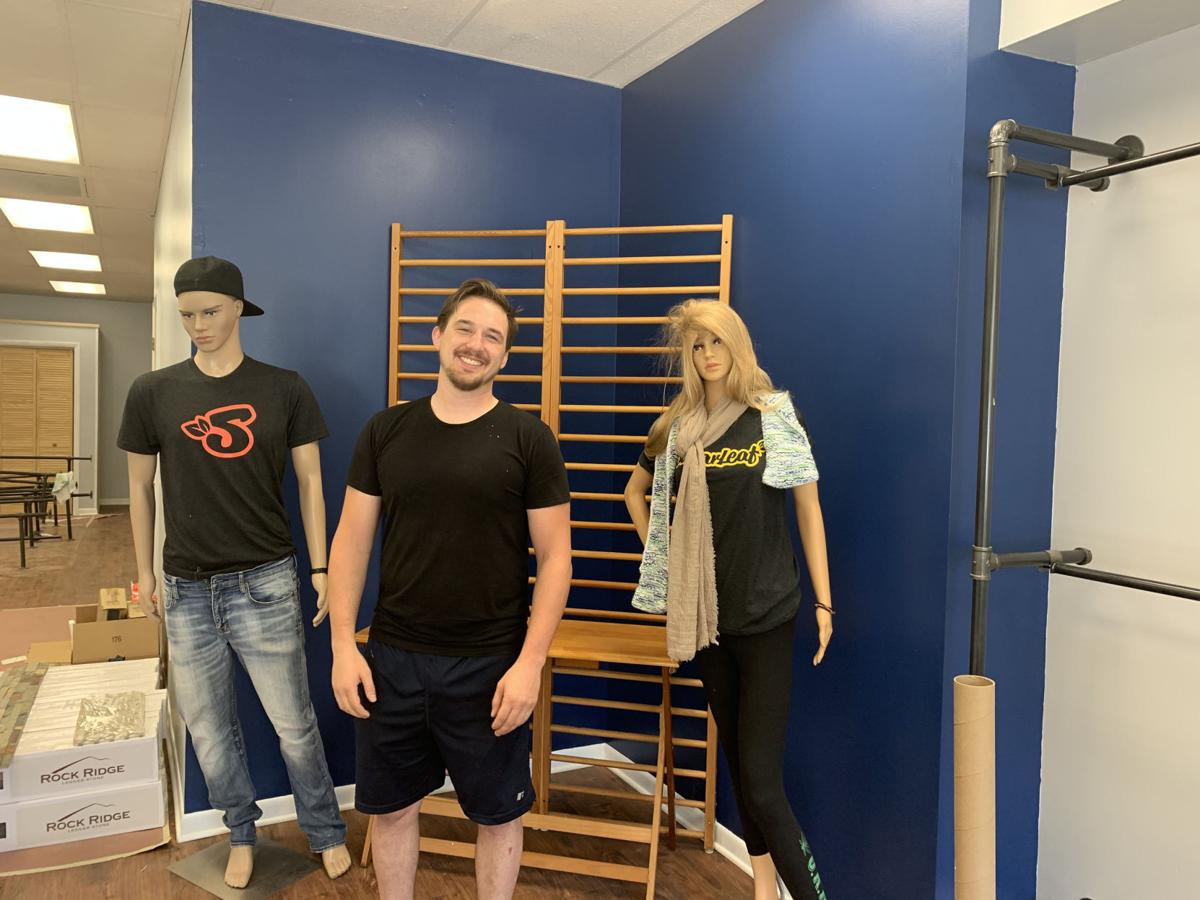 Tyler Dempsey, owner of Holistic Connections in Lake Geneva, stands next to some mannequins