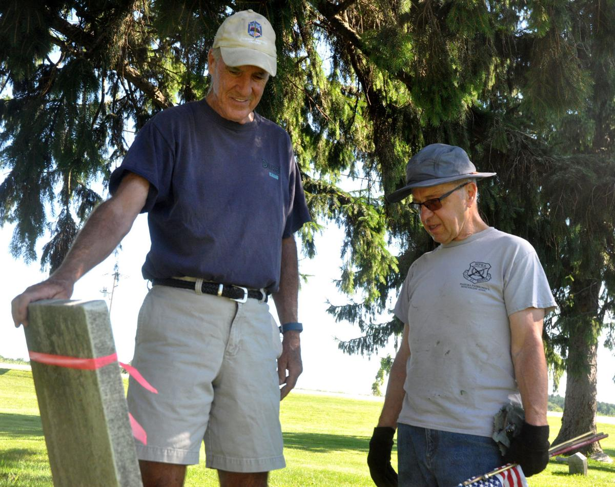 Jerry Hawver, left, and Tim Walters, members of the St. Francis de Sales Cemetery Committee