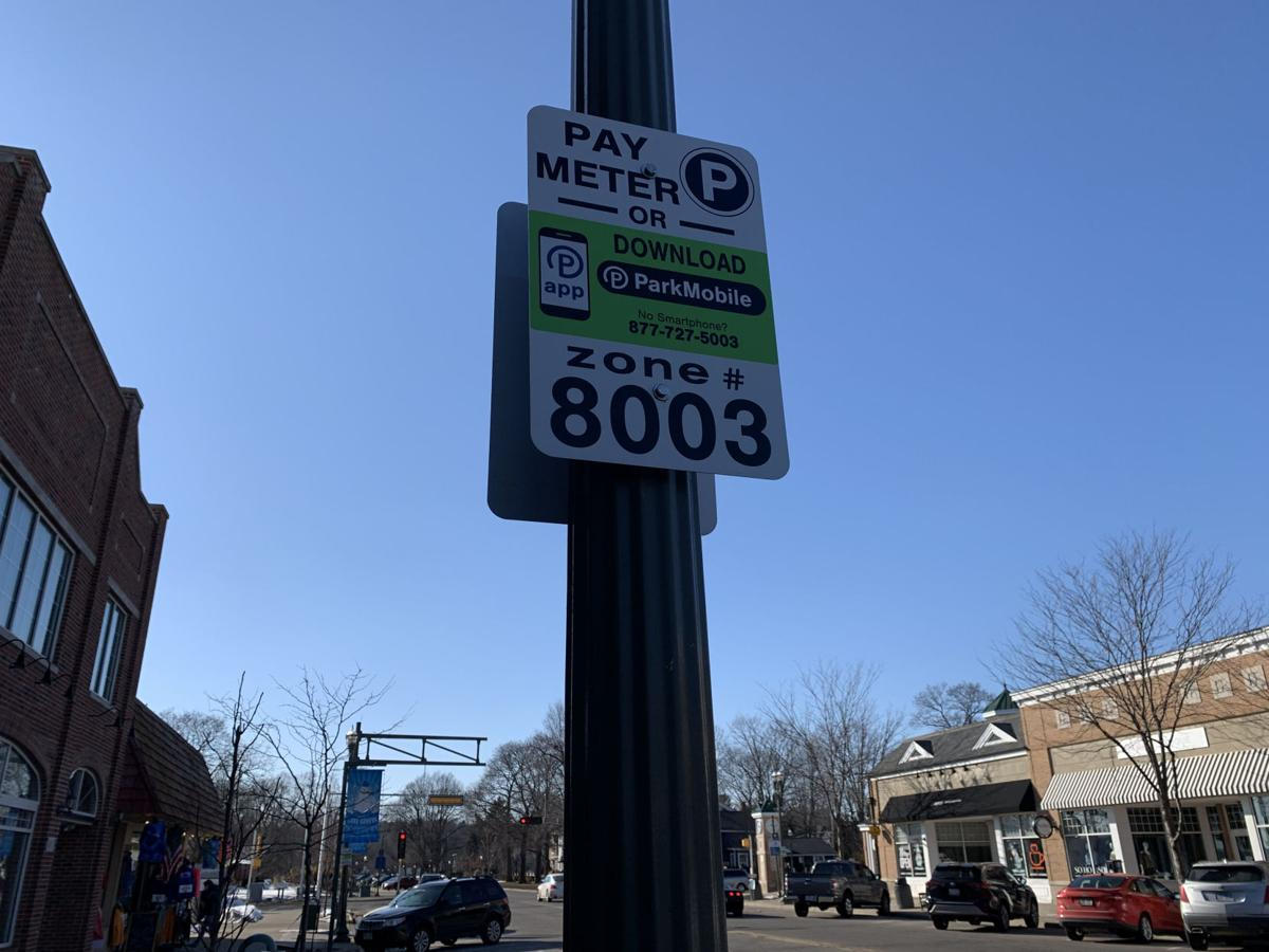 Signs have been placed throughout the downtown area to indicate where paid parking zones are located