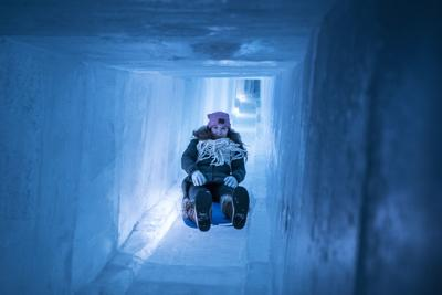 Visitors to the ice castle structures in Lincoln, New Hampshire have enjoyed sliding down