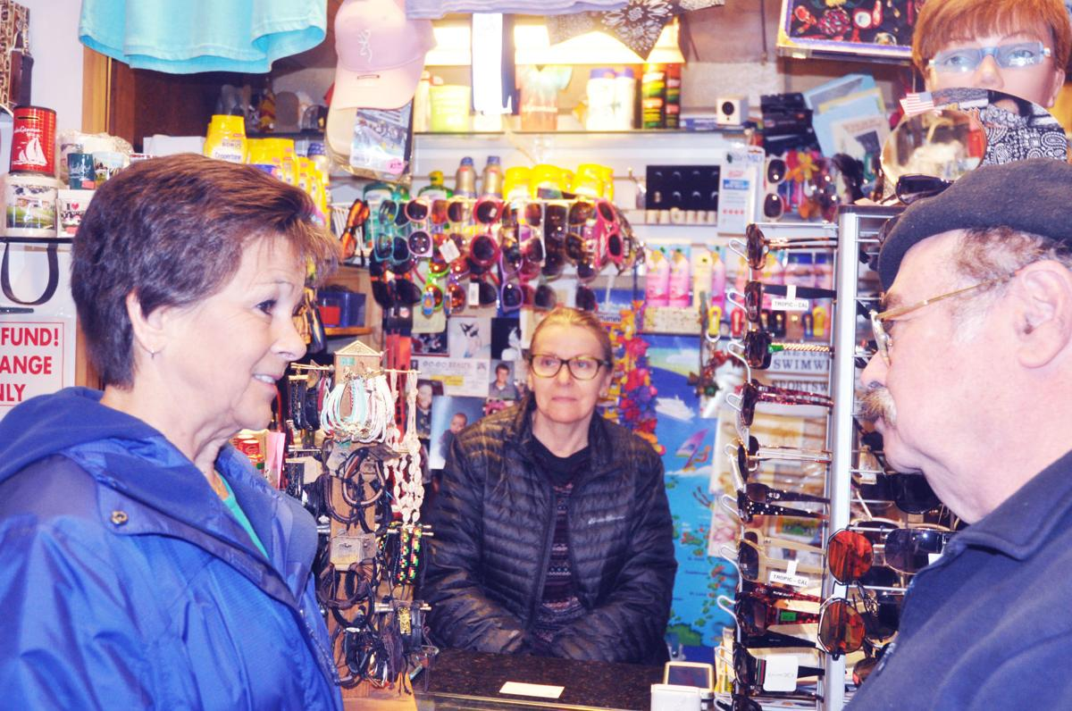 Harbormaster Linda Frame, left, meets with Riviera shop owners Iwona Gogo and Sol Kaniuk