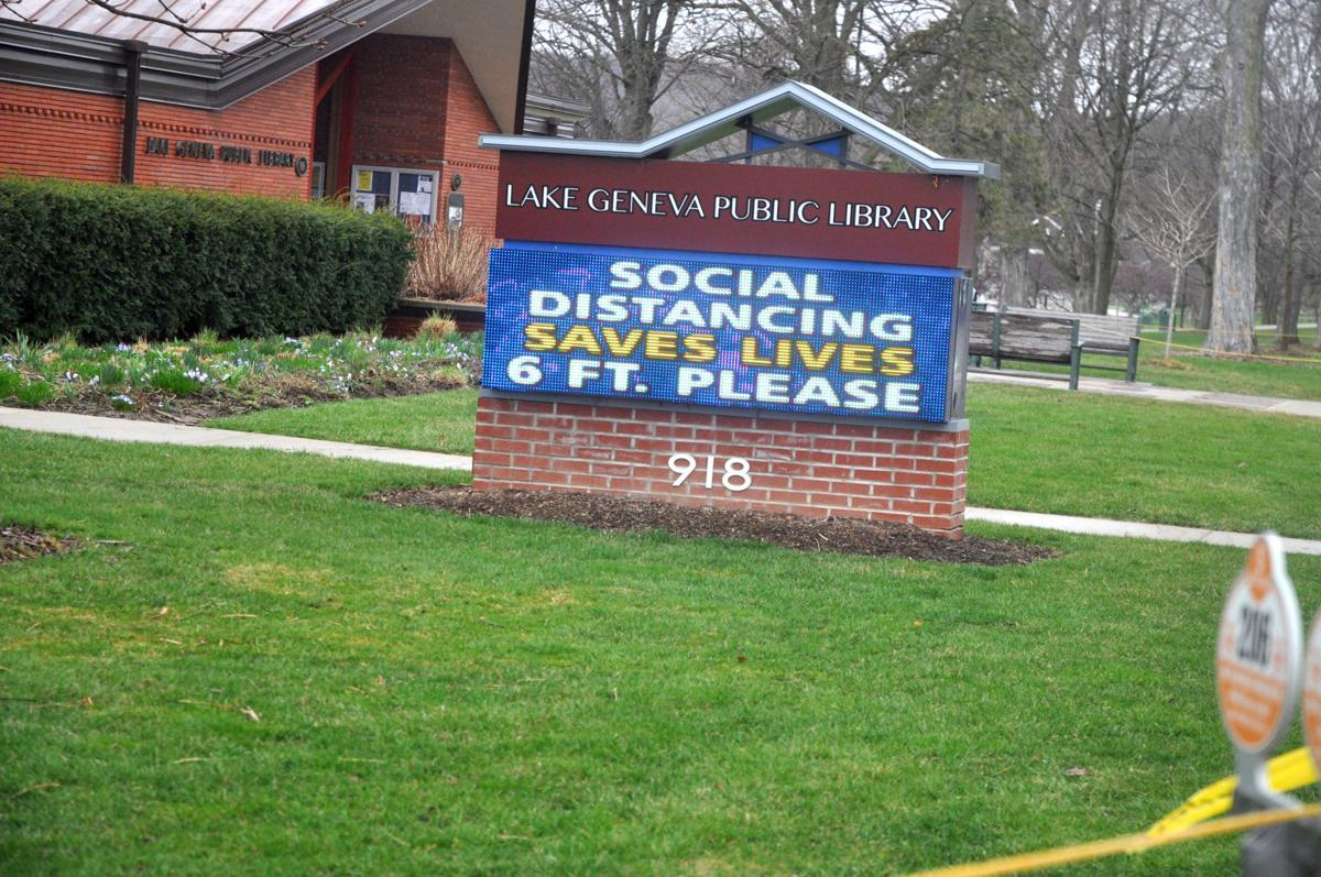 An electric sign next to the Lake Geneva Public Library encourages people to practice safe