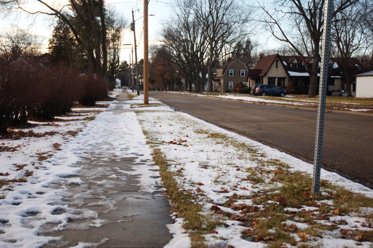 Snowy sidewalk in Village of Walworth