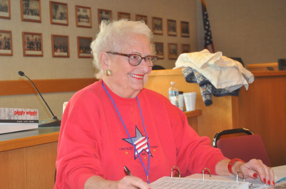 Barbara Braden prepares to check in voters during the April 2 election