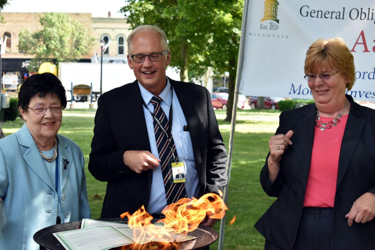 County holds 'mortgage burning' party