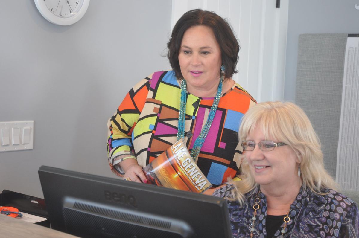 VISIT Lake Geneva President Stephanie Klett and employee Sandy Biging look up some information
