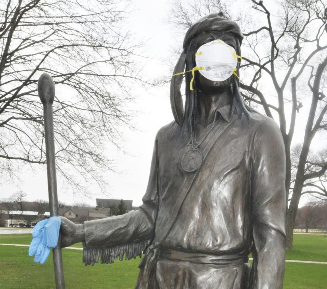 Chief Big Foot statue with hospital mask during coronavirus crisis
