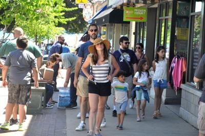 People crowd city sidewalks during a recent weekend, as more people have been visting the