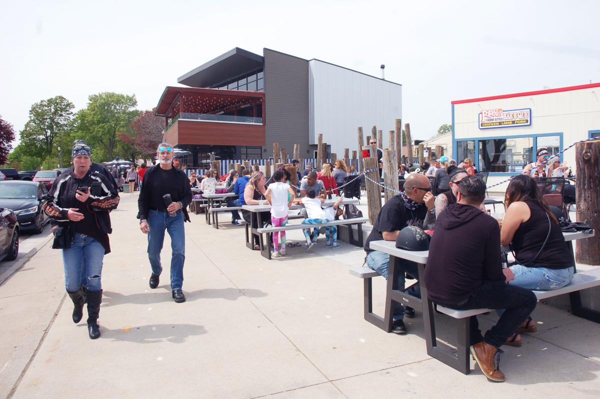 Popeye's outdoor patio fills up during first Saturday back