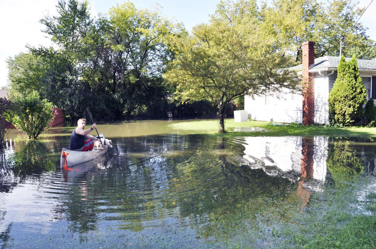 Dillan Schneider man in canoe flooding