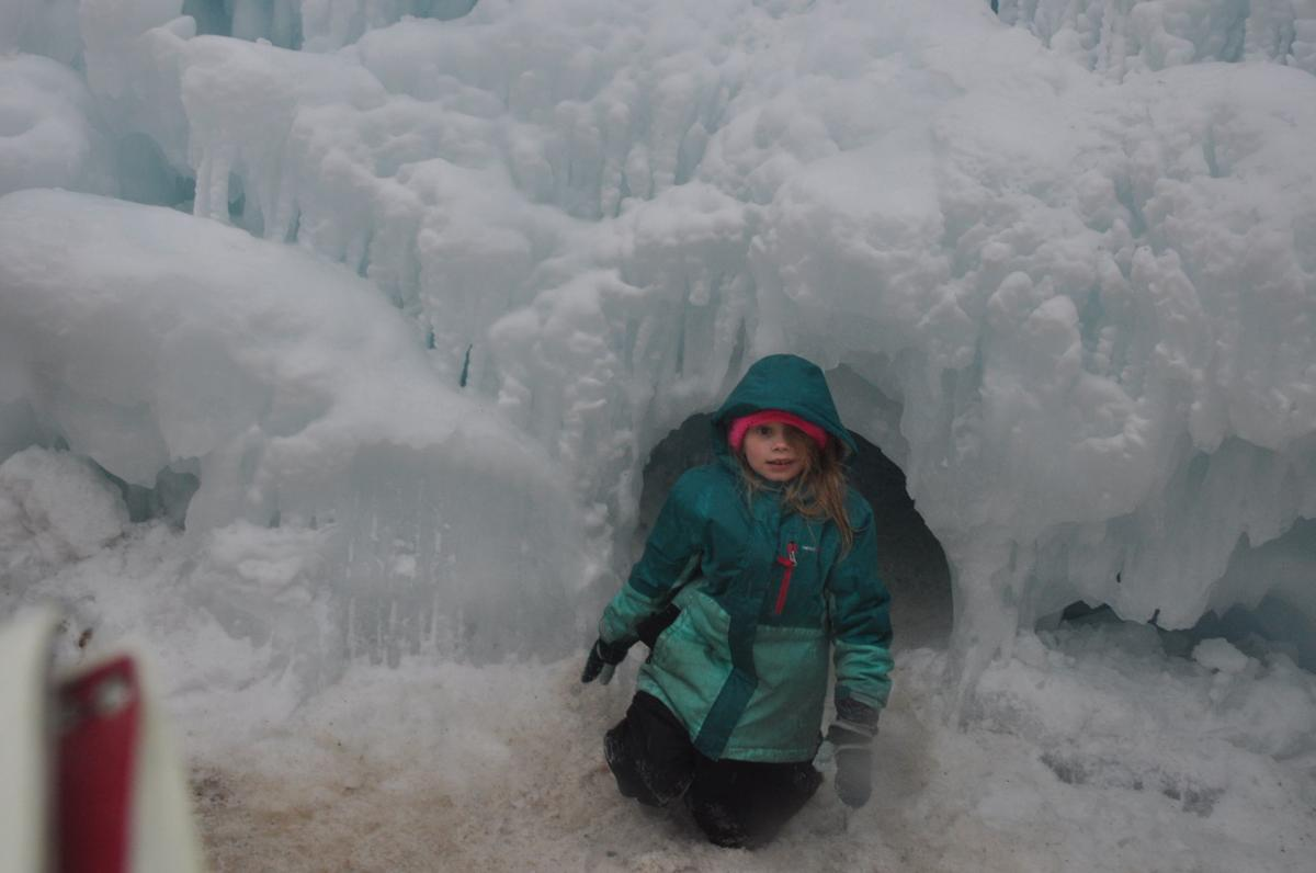 Ava Rasch, 7, of Genoa City finishes crawling through an ice castle tunnel