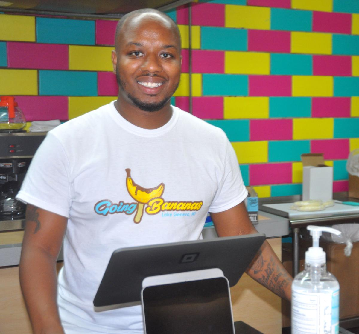 Joseph Hatten, co-owner of Going Bananas, stands at the counter of the recently-opened