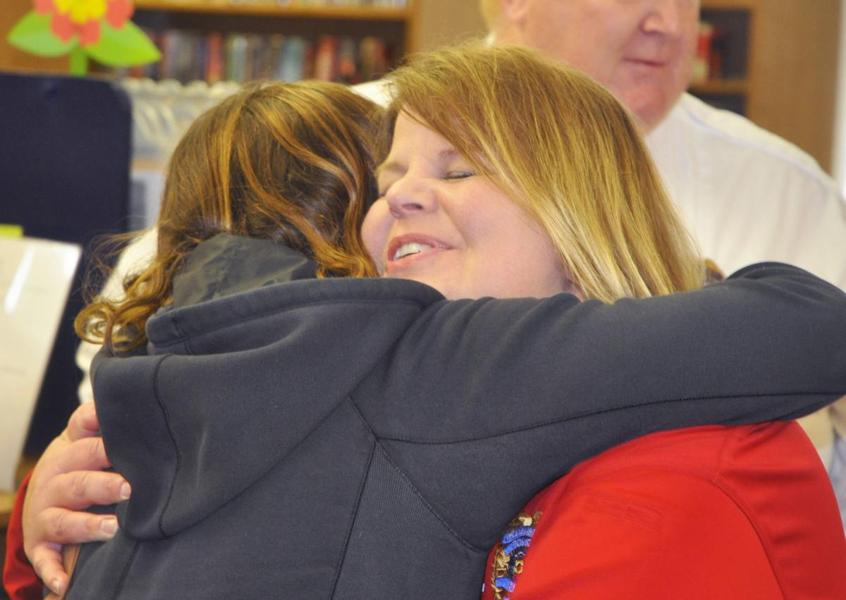 Police Chief Laura Washer hugging Jen McMannamy