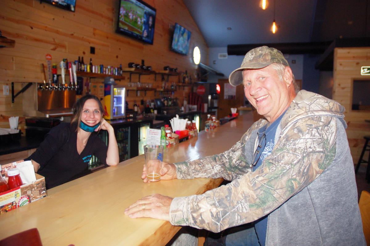 Bartender Tara Costa and customer Ed Snyder at Broken Spoke