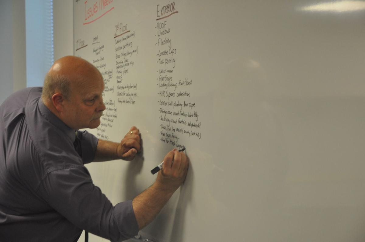 City Administrator Dave Nord writes down ideas that are being proposed for the Riviera