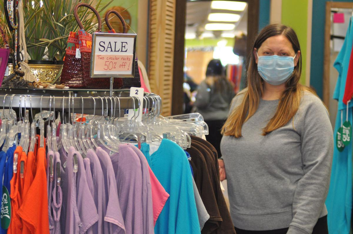Katie Urban, store manager at Oh My Gauze in downtown Lake Geneva, stands next to clothing items