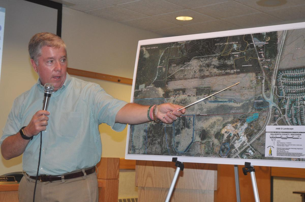 Clancy Green, development coordinator with Keefe Real Estate, presents plans for a proposed new YMCA