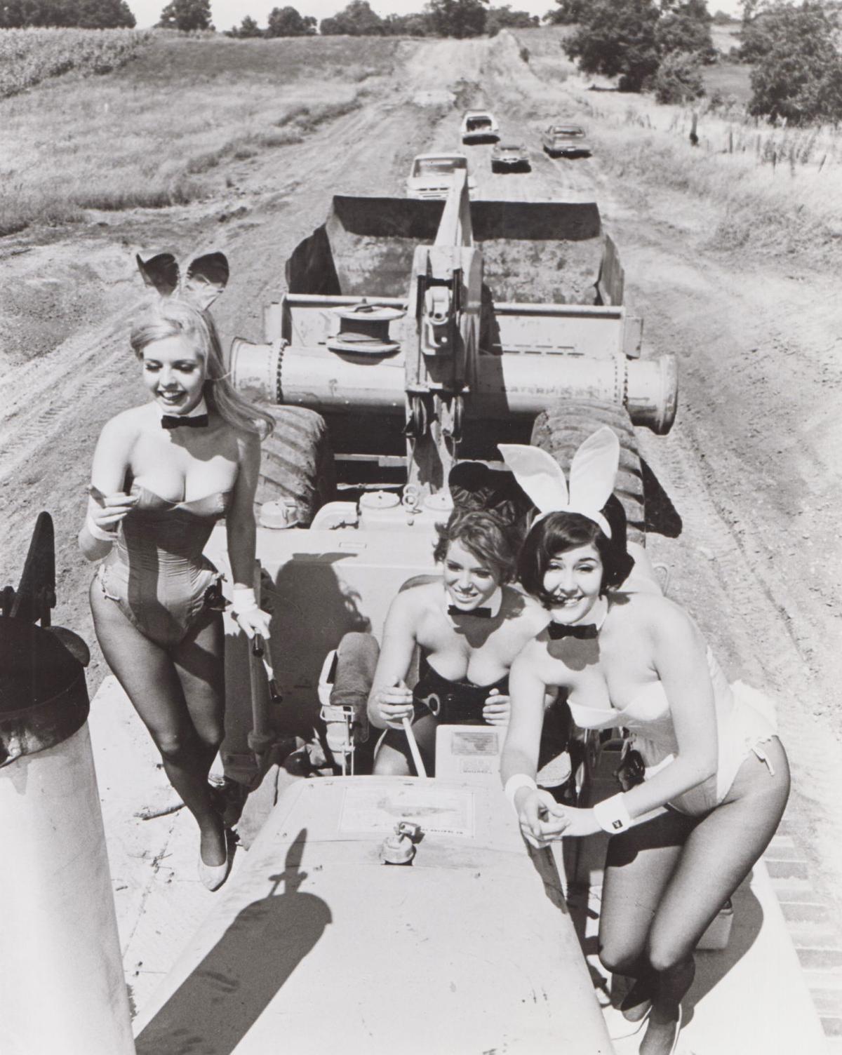 Playboy Club bunnies on construction equipment