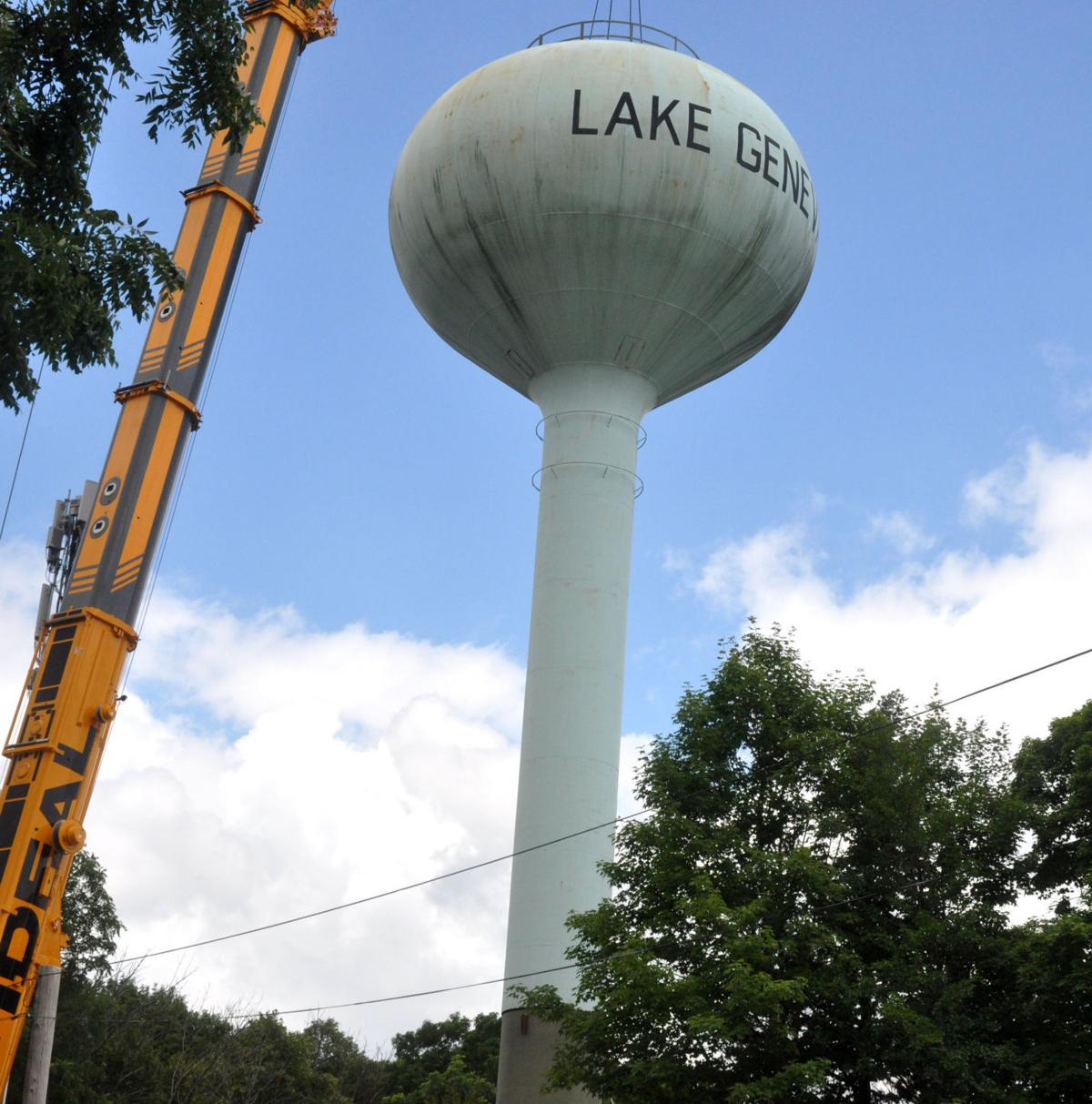 City crews attach the Dogde Street water tower on top of a 30-foot extension, July 23