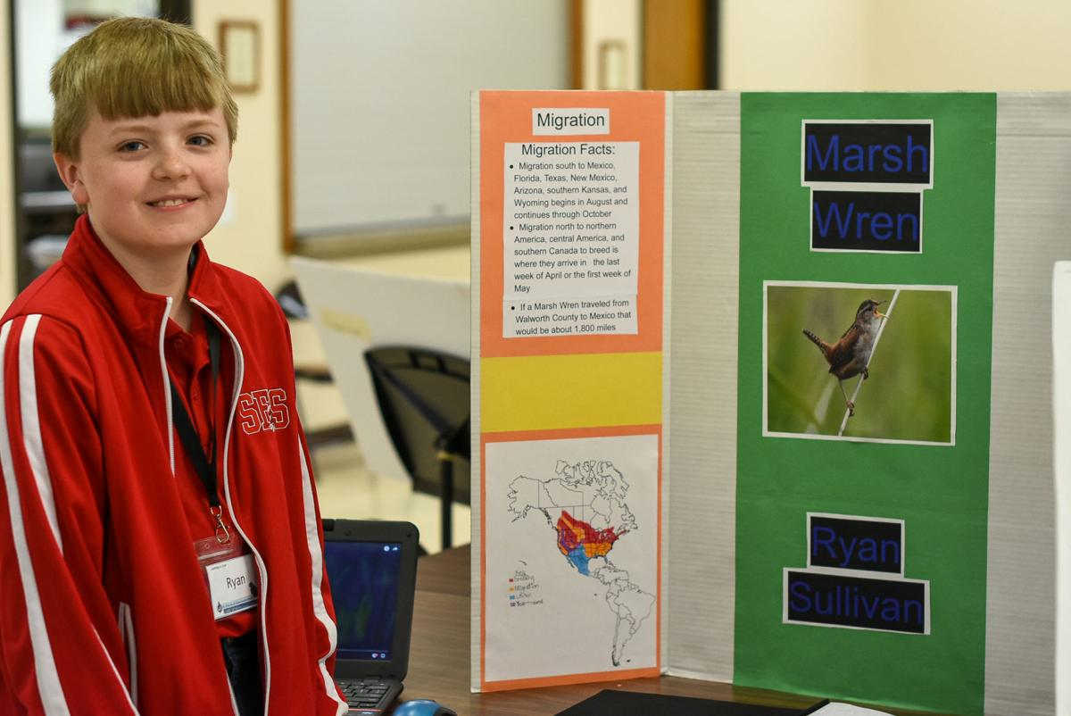 Ryan Sullivan, fifth-grade student at St. Francis de Sales School, received an award for his bird travel guide project