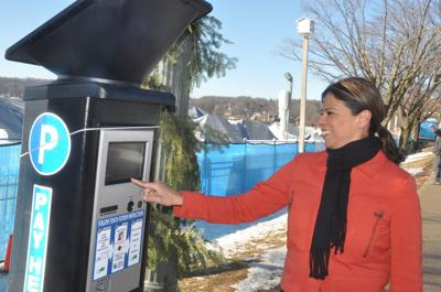 Parking Operations Manager Sylvia Martinez-Mullally checks over a temporary parking kiosk