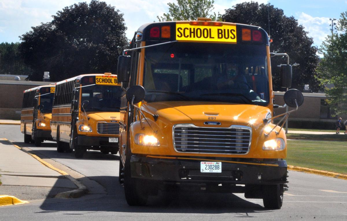 School buses at Badger High School prepare to take students home as the school day