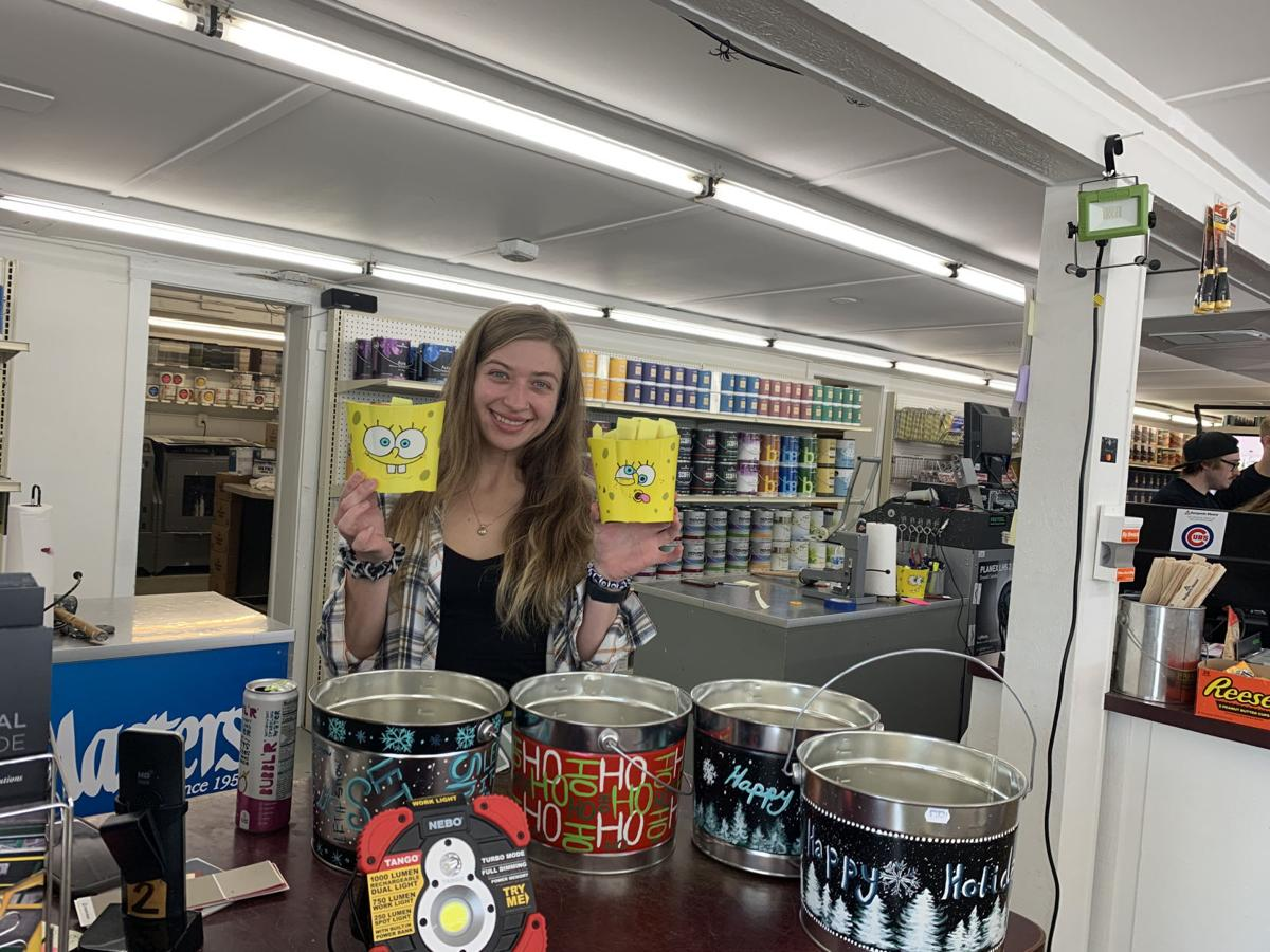 Besides window paintings, Tara Laine also has painted designs and logos on buckets and containers