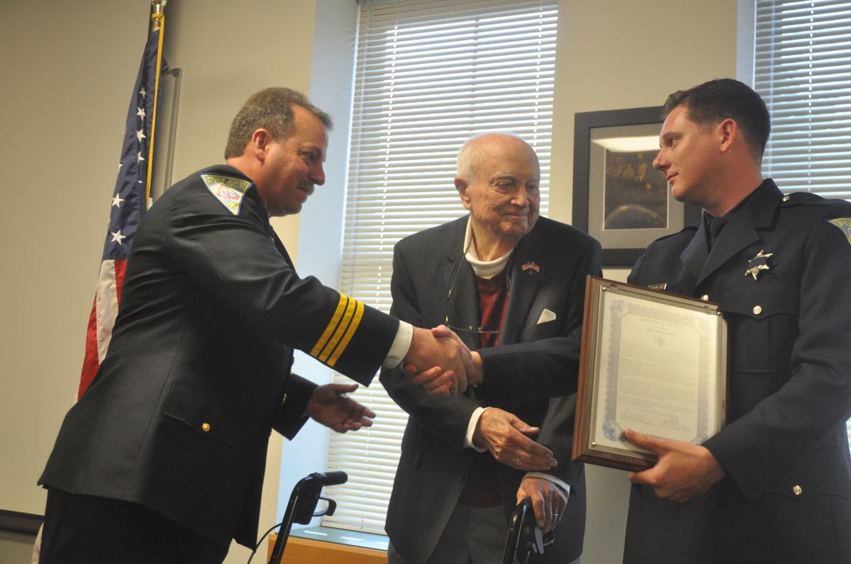 Officer Brock Bouland, right, receives the Lake Geneva Police Department's Albert C. Exner