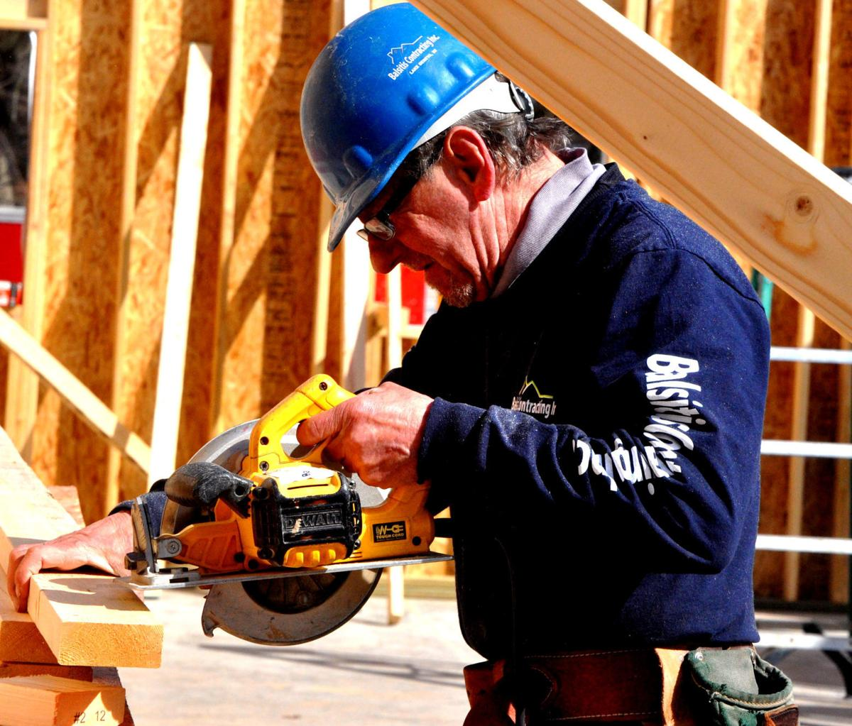 An employee from Balsitis Contracting does some drilling work