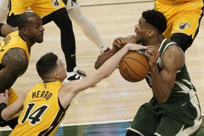 Tyler Herro strips Giannis Antetokounmpo, AP photo