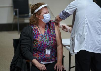 Nursing home nurse gets COVID-19 vaccine