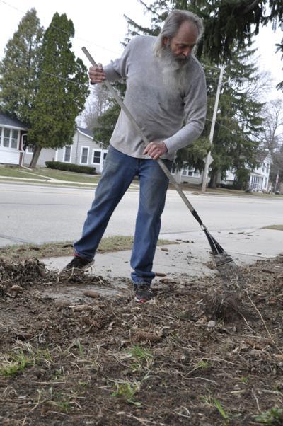 Bill Robers does yard work on Williams Street
