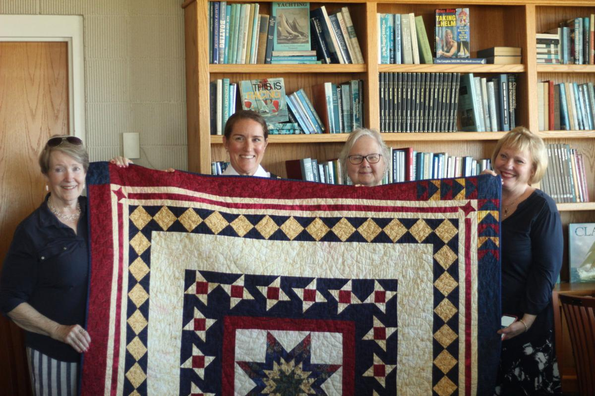Group Photo with Major Gretchen Gaskins and her quilt