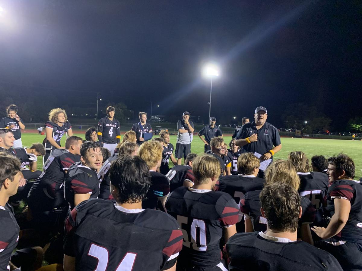 Head Coach Matt Hensler congratulates his team