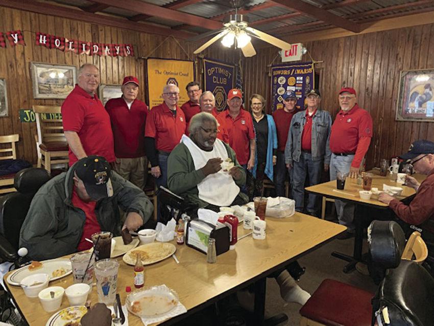 Lake Oconee Elks pose with a few of the Veterans.jpg
