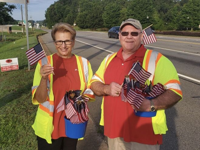 Mary Zachary and Jon Dill give out Flags to motorist.jpg