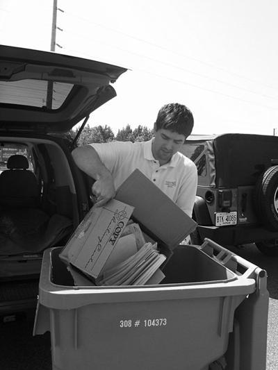 FMB Loan Officer, Greg Chamberlain dumping shreadable material.jpg