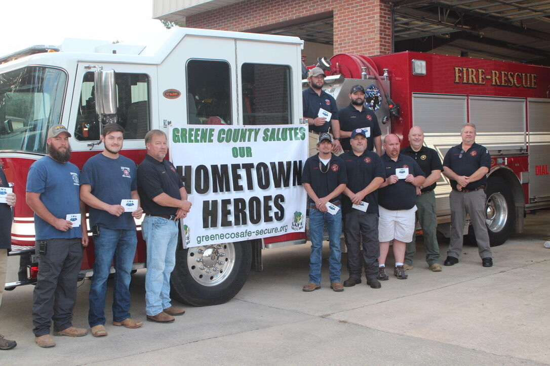 Firefighters at the Greensboro Fire Department receiving gift cards from Hometown Heroes.jpg
