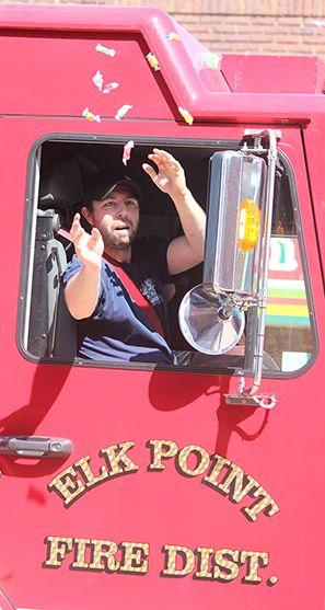 Fireman throwing candy