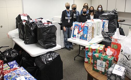 Angel Tree gifts fill office
